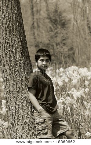 An handsome indian kid model posing at a local park