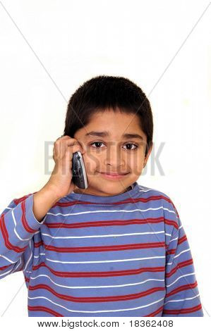 An handsome Indian kid talking on the phone