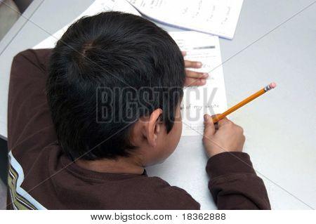 handsome Indian kid doing his homework
