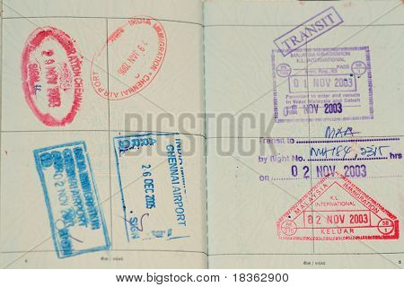 Passport immigration stamps and boarding pass, ready to travel