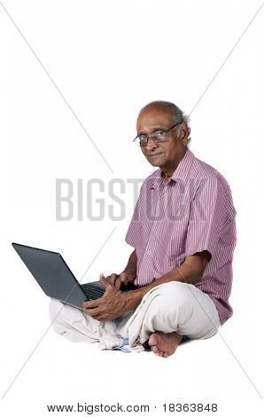an old Indian man surfing the net after retirement