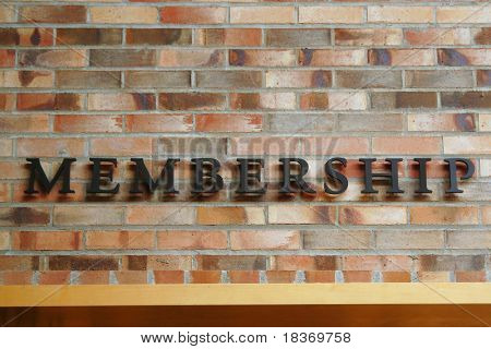 Membership Sign on Brick Wall