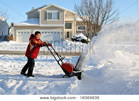 Young Boy Blowing Snow