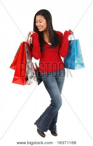 happy smiling asian female shopper holding shopping bags isolated on white background
