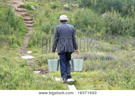 man with two bucketful of water
