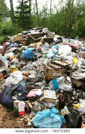 so much rubbish in green forest