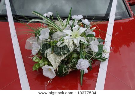 wedding bouquet on red car