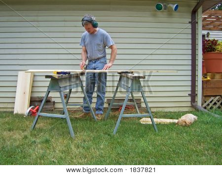 Man Marking Lumber