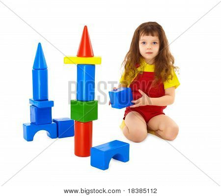 Child Builds A Toy Castle On Floor