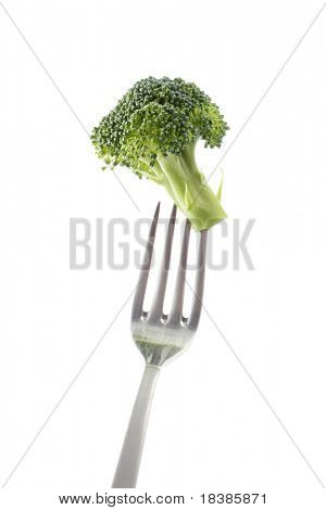 broccoli in a fork isolated on white