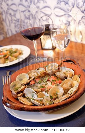 traditional portuguese clams and fish dish