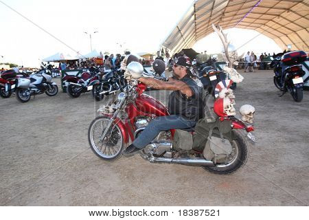 FARO, PORTUGAL - JULY 17: motorbyker ridding his motorbike at  Internacional motorcycle show July 17 2010 in Faro, Portugal.