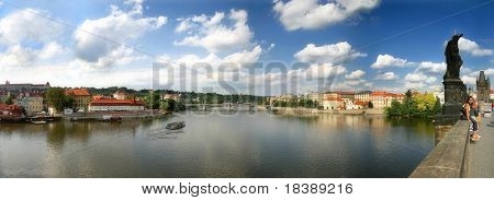 Panoramic view on Vltava River and old part of town from Charles Bridge in Prague, Czech Republic.