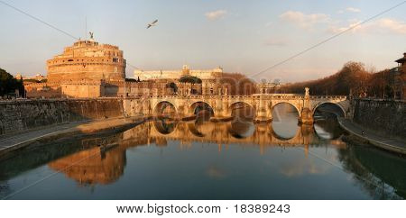 Panorama of Saint Angel castle, bridge and Tiber river in Rome, Italy.