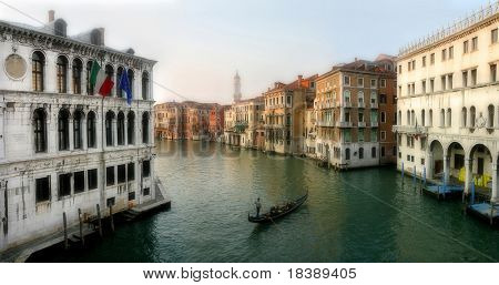 Panoramic view on famous Grand Canal among old historic buildings as seen from Rialto Bridge in Venice, Italy.