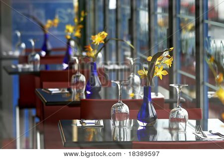 Restaurant interior with tables and wine glasses in Paris, France.