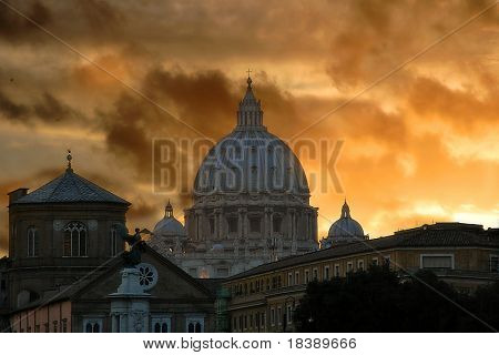 View on Saint Peter (San Pietro) cathedral at sunset in Vatican city, Vatican (Rome, Italy).