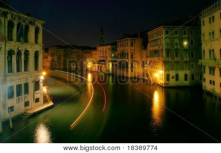 Grand Canal and old historical houses at night as seen from Rialto bridge in Venice, Italy.