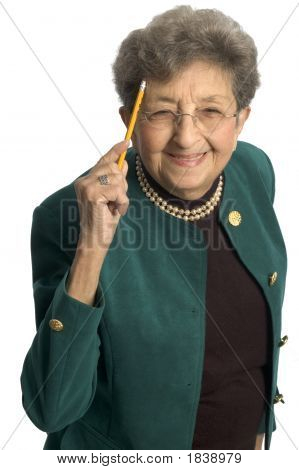 Healthy Senior Woman Pointing To Head