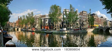 Panoramic view on historic city center and city canal in Amsterdam, Netherlands.