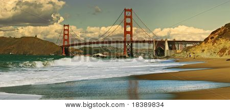 Panoramic view on Golden Gate bridge as seen from Baker Beach in San Francisco, California.