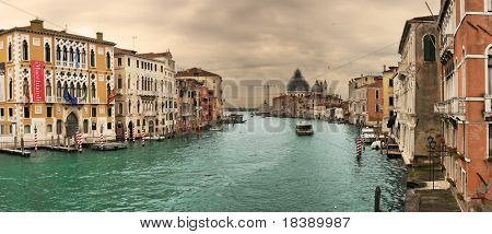 Panoramic view on famous Grand Canal among historic houses in Venice, Italy.
