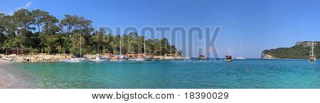 """Panoramic view on beautiful bay in Kemer, Turkey known also as """"Moonlight Beach""""."""