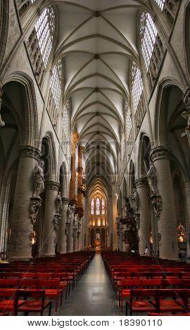 Vertical oriented image of catholic church interior located in Brussels, Belgium.