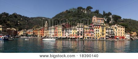 Panoramic view on bay and multicolored houses in Portofino - small town on Ligurian Sea in Italy.