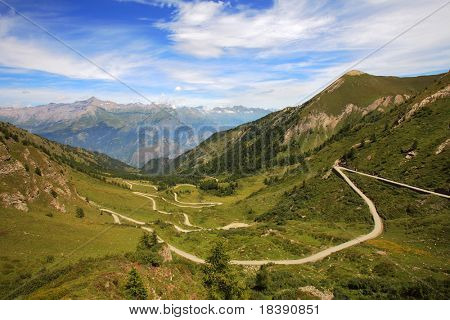 Unpaved road among hills and mountains in northern Italy.