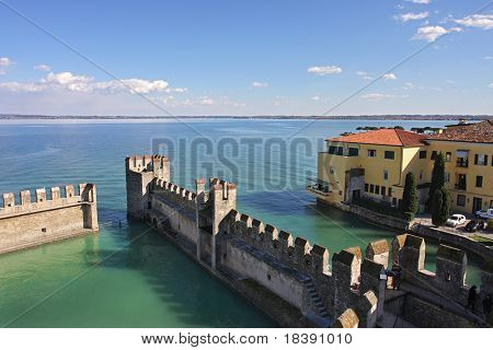 Aerial view on Lake Garda and ancient fortification in Sirmione, Italy.
