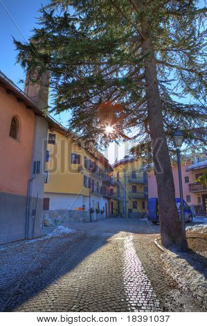 Vertical oriented image of small street in Limone Piemonte - famous touristic town in northern Italy.