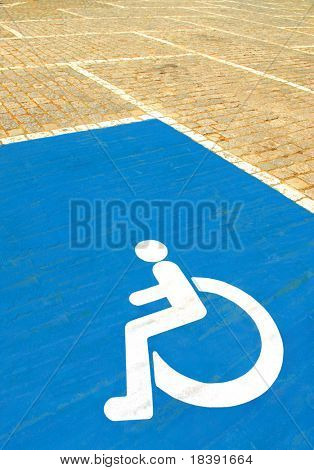 parkingspace for disabled with wheelchair symbol on blue paint