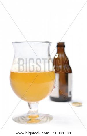 cold drinks: belgium beer in glass and a bottle with shallow dof