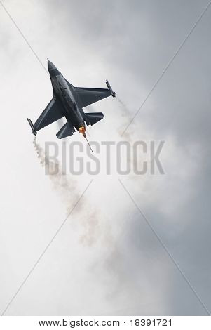 f16 fighter airplane flying on light cloudy background to use as wallpaper or dvd cover