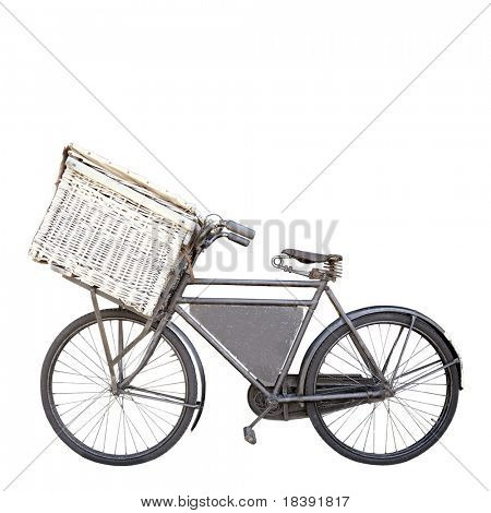 vintage rusty dutch old carrier bike with shopping basket isolated on white