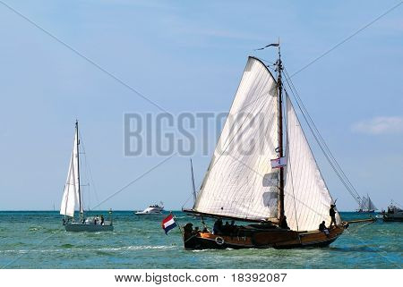 sailboats sailing on the sea with blue sky background