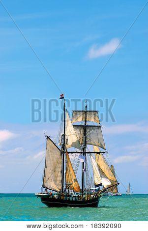 nostalgic pirate-ship sailing the caribbean on a sunny day