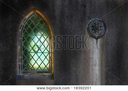 leaded lights quarrel window in old weathered family grave