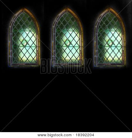 leaded lights quarrel windows in old weathered family grave isolated on black