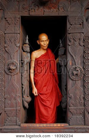 burmese buddhist monk in teak wooden monastery