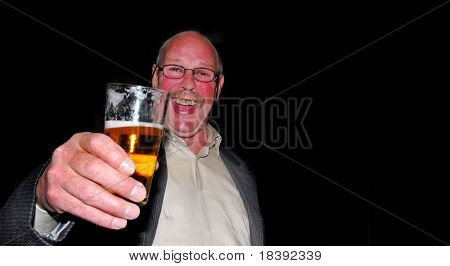 cheers! happy man with red cheeks drinking a beer at a party isolated on black background
