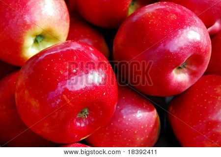 background of red shiny apples