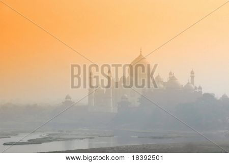 worldwonder taj mahal in early morning fog by sunrise