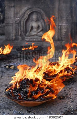 offering fire to buddha in swayambunath or monkey temple in kathmandu nepal