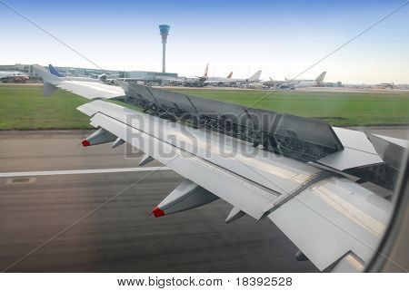 view on wing with brakes on, during landing at heathrow airport, london, UK
