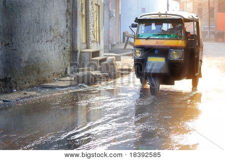 motor rickshaw in jaipur after monsoon or flood