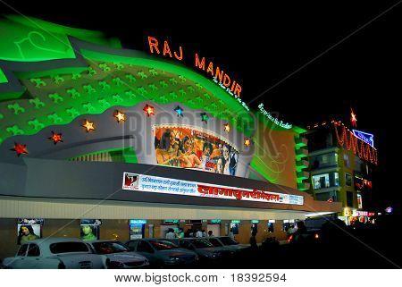 green lit movie theater raj mandir in jaipur, india, by night