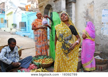 colorful women on local market in orchha, india