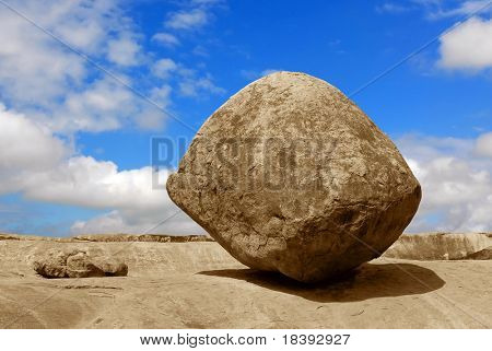 Conceptual image of a balancing rock in Mahabalipuram, India